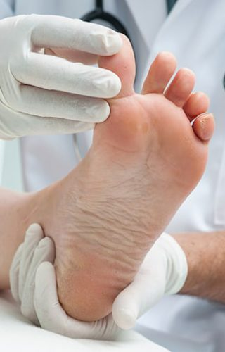 chirpodist man treating foot
