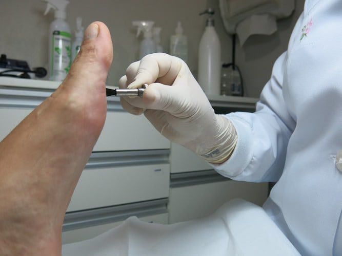 podiatrist treating toes